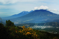 Volcanos. Three Volcanoes and a Village in Guatemala Stock Images