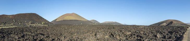 Volcanos in Timanfaya national park near Mancha Blanca Stock Photo