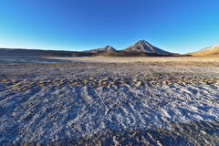 Volcanos view from Laguna Lejía. This lagoon is located in the Atacama desert near Lascar volcano in Chile stock images