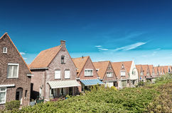 Volendam, Netherlands. Classic homes aligned along city street Royalty Free Stock Image