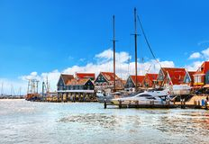 Volendam, Netherlands. High-speed motorboat by docks. Near old traditional town not far from Amsterdam. Famous touristic landmark with northern sea and sunny royalty free stock photos