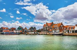 Volendam, Netherlands. High-speed motorboat by docks. Near old traditional town not far from Amsterdam. Famous touristic landmark with northern sea and sunny stock images
