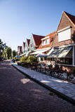 VOLENDAM, NETHERLANDS - JUNE 18, 2014: Traditional houses & streets in Holland town Volendam, Netherlands. Stock Photo