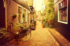 Volendam. Netherlands. Volendam. Narrow old street in the picturesque fishing village at sunset Stock Images