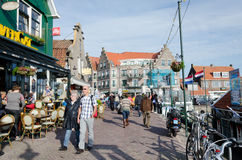 Volendam. NETHERLANDS - OCTOBER 22: A view of a street of  on October 22, 2013.  is world famous thanks to its traditional costumes and its contributions to Royalty Free Stock Photography