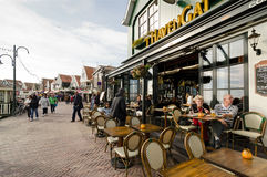 Volendam. NETHERLANDS - OCTOBER 22: A view of a street of  on October 22, 2013.  is world famous thanks to its traditional costumes and its contributions to Royalty Free Stock Images