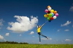 Voler avec des ballons photographie stock libre de droits