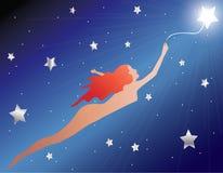 Voler avec une étoile Image libre de droits
