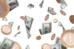 Voler de billets de banque et de pièces de monnaie du dollar Photo stock