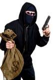 Voleur à capuchon avec une arme à feu et un sac Images stock