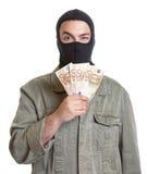 Voleur avec l'argent volé Photo stock