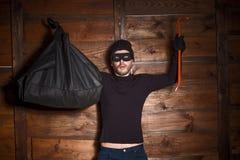 Voleur masqué photographie stock libre de droits