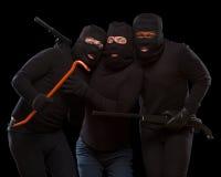 Voleurs dans les masques photos stock