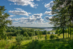 Volga expanses. Volga landscape on a bright and Sunny day. Blue sky and white clouds royalty free stock photography