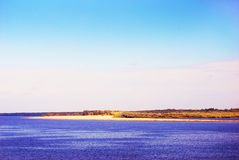 The Volga river panorama at dawn. A sandy shore. Stock Photos