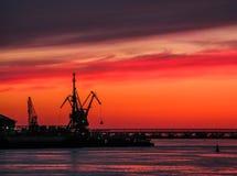 Volga river. Silhouettes of cranes. Royalty Free Stock Photo