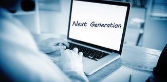Volgende generatie tegen zakenman die aan zijn laptop werken Stock Foto's