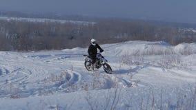 Volgograd. Russia, 2019.Children bikers rider on snowy motocross track. Rider on snow. Motocross rider on bike