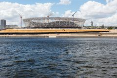 Iron framework of stadium to sporting events. VOLGOGRAD, RUSSIA - July 5, 2017: Construction of an iron framework of stadium with tower cranes to sporting events Royalty Free Stock Photo