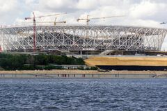 Iron framework of stadium to sporting events. VOLGOGRAD, RUSSIA - July 5, 2017: Construction of an iron framework of stadium with tower cranes to sporting events Royalty Free Stock Photography