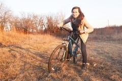 The girl rides a bike Stock Photo