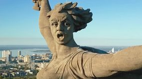 Statue of Motherland in Volgograd. View from the drones close. Victory Monument. Volgograd, Russia - May 14, 2018: Statue of Motherland in Volgograd. View from royalty free stock image