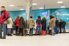 Volgograd, Russia - October 31.2016. Passengers await the luggage around baggage carousel in C terminalan of Aeroport. Volgograd, Russia - October 31.2016 Royalty Free Stock Images