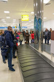 Volgograd, Russia - October 31.2016. Passengers await the luggage around baggage carousel in C terminalan of Aeroport. Volgograd, Russia - October 31.2016 Royalty Free Stock Photography