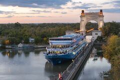 Free Volgograd, Russia - September 20, 2019. A Cruise Ship With Tourists Passes Along The Volga-Don Shipping Canal Named After Lenin At Royalty Free Stock Image - 182475926