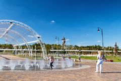 Recreation Park with a dry fountain and benches in front of the. VOLGOGRAD, RUSSIA - SEPTEMBER 22: Recreation Park with a dry fountain and benches in front of royalty free stock photo