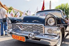 Restored and painted in shiny metallic black Chaika GAZ-13 at the. VOLGOGRAD - SEPTEMBER 9: Restored and painted in shiny metallic black Chaika GAZ-13 at the Stock Image