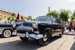 Restored and painted in shiny metallic black Volga GAZ-21 at the Stock Image
