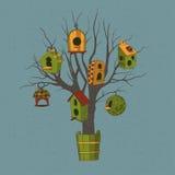 Voljärer på ett träd Vektor Illustrationer