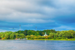 Volkhov river and Church of St. John the Evangelist on Vitka river in Veliky Novgorod, Russia. Summer landscape - Volkhov river and Church of St. John the Royalty Free Stock Photo