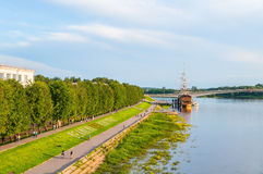 Volkhov river water area and embankment of Alexander Nevsky with people walking along in Veliky Novgorod, Russia. VELIKY NOVGOROD, RUSSIA - JUNE 21, 2016. Summer Stock Photo