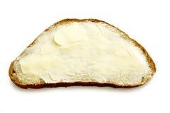 Volkorenbrood met boter Stock Fotografie