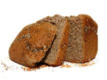 Volkorenbrood met zaden, besnoeiing in plakken Stock Foto