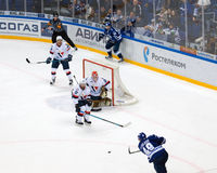 A. Volkov (49) attack. MOSCOW, RUSSIA - OCTOBER 12, 2016: A. Volkov (49) attack on hockey game Dynamo Moscow vs Slovan Bratislava on Russia KHL championship Royalty Free Stock Photo