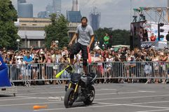 A.Volkov juggling pins on a motorcycle stock images