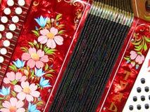 Volksambachten Nationaal muzikaal instrument Russische harmonika Royalty-vrije Stock Afbeelding