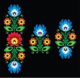 Volksstickerei mit Blumen - traditionelles polnisches Muster Wzory Lowickie Stockbilder