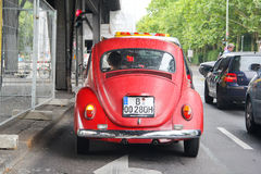 Volkswagen Beetle. BERLIN, GERMANY - AUGUST 15, 2014: Red classic vintage car Volkswagen Beetle in the city street Stock Photo