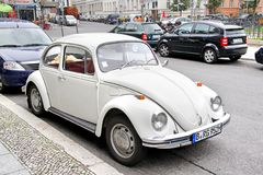 Volkswagen Beetle. BERLIN, GERMANY - SEPTEMBER 12, 2013: White Volkswagen Beetle retro car at the city street Stock Photo