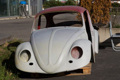 Volkswagen Beetle Car body that's in the process of being restored. Rural Norway - August 17, 2014: Volkswagen Beetle Car body that's in the process of being Stock Photos