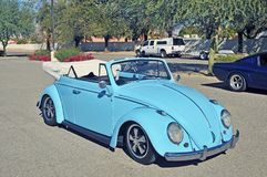 Volkswagen Beetle Convertible. The Volkswagen Beetle convertible has a body by Karmann Ghia which sets it apart. This car is lowered and has Porche wheels stock image