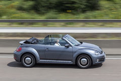 Volkswagen Beetle Convertible on the road Royalty Free Stock Image