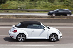 Volkswagen Beetle Convertible on the road Royalty Free Stock Photography