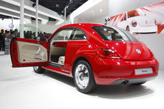 A Volkswagen Beetle on display at Auto Expo 2012 Royalty Free Stock Photo