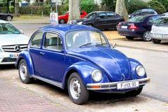Volkswagen Beetle. FRANKFURT AM MAIN - SEPTEMBER 15, 2013: Blue Volkswagen Beetle vintage car at the city street Royalty Free Stock Photo