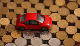 Volkswagen Beetle model on top of coins stock photo
